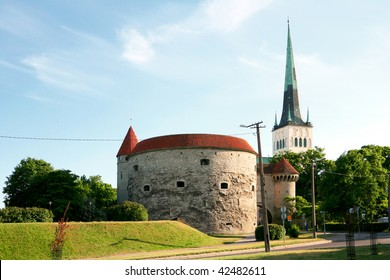 Thick Margarita an old tower in Tallinn on a background church Oleviste ,Estonia ,the Baltic countries