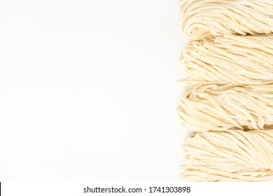 Thick noodles made from wheat flour on white background