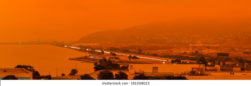 Thick orange haze above San Francisco on September 9 2020 from record wildfires in California, daytime view of ash and smoke floating over the Bay Area
