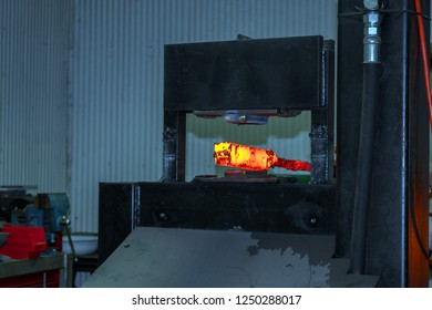 A thick red hot billet will soon be a thin and long piece of workable metal by the skill of the blacksmith and a power hammer.