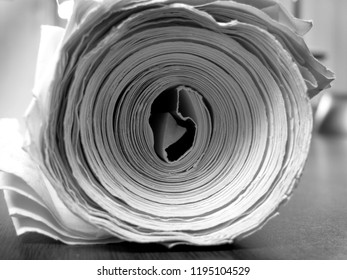 Thick roll of white paper for writing newspaper or blueprints and drawings