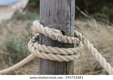 Bound to pole with rope with you