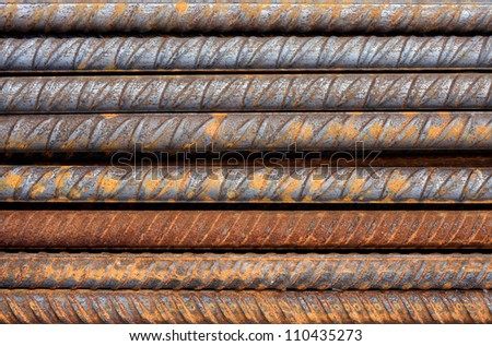 Thick rusty rebar-rods, metallic texture pattern.