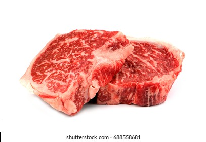 thick slice wagyu beef steak raw cut in half piece isolated on white background