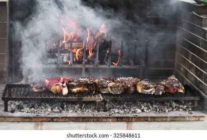 Thick slices of meat from chianina cow grilling over the embers