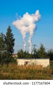 thick smoke belching from factory chimneys