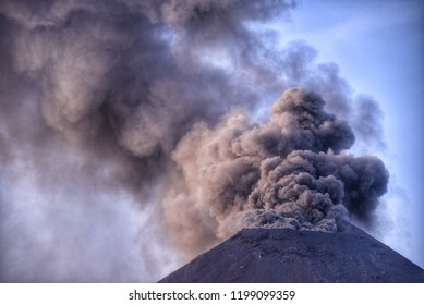 Thick smoke billowed out of the crater of Anak Krakatau mountain