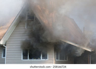 Thick smoke engulfs a home, foreshadowing the blazing destruction to come.