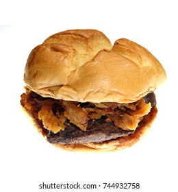 Thick-cut venison steak, topped with crispy onions, and a juniper berry sauce. Venison sandwich on a crisp bun, isolated on white.