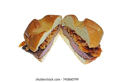 Thick-cut venison steak, topped with crispy onions, and a juniper berry sauce. Venison sandwich on a bun, isolated on white.