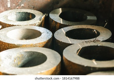 Thick-walled iron pipes sawn on a band saw hidden in a metal box.
