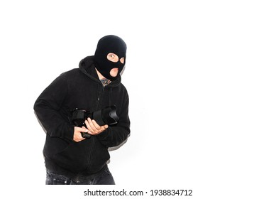 thief with balaclava and tattoos on white background. Person stealing photo camera. Crime and delinquency. Home security and insurance.