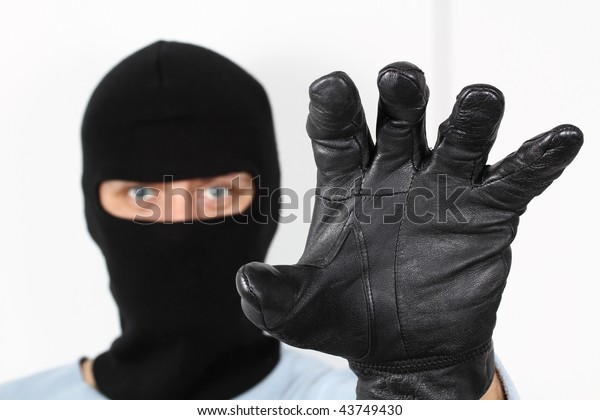 Thief, bandit, or mugger reaching for you. This file has a clipping path.