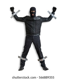 Thief or burglar masked with balaclava is caught and is taped to the wall with adhesive tape. Isolated on white background.