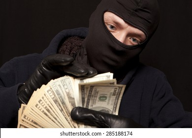Thief and cash. Showing a thief counting the money