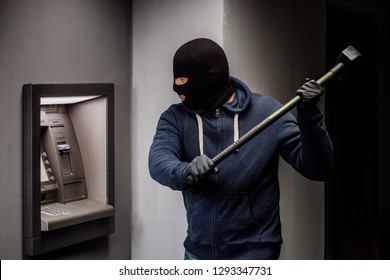 Thief. Hacker stealing money from ATM machine. Phishing, ATM skimming
