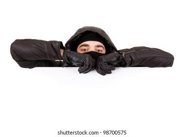 Thief lurking on white background
