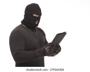 Thief or man in a ski mask and digital tablet on a white background.