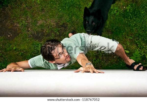 Thief running away from the dog.
