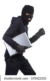 Thief stealing a laptop computer. Isolated on white background
