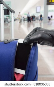 thief steals  the smart phone of the suitcase at the airport