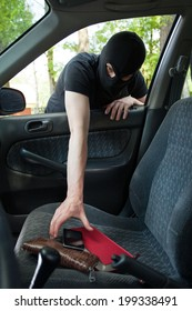 A thief steals someone's phone from the car