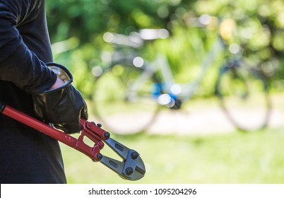 a thief tries to steal a bicycle with a tool