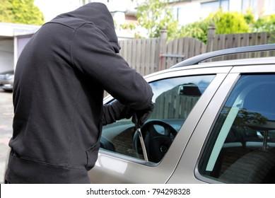 A thief tries to steal a car