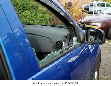 Thiefs have broken a car window to steel items inside