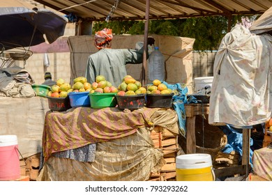 THIES, SENEGAL - APR 26, 2017: Unidentified Senegalese woman sells mango at the market in Thies, the third largest city in Senegal