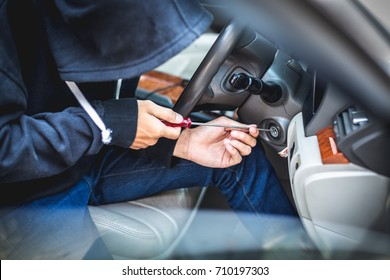 Thieves dressed robber with masks, equipment tamper keyway to connect the car traction. Prior to steal cars and valuables of the victims
