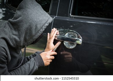 Thieves are stealing cars.
