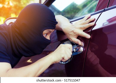 Thieves trying to open car door.