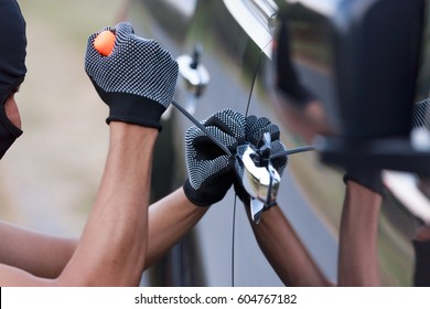 Thieves trying to open The car door.Security  concept.