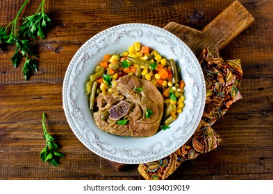 Thigh of turkey stew with vegetables: corn, green beans, carrots and bell pepper