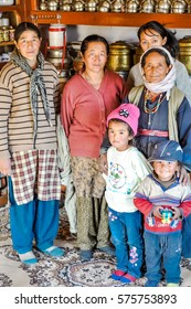 Thiksey, Ladakh - circa November 2011: Women pose with two small children in Thiksey, Ladakh. Documentary editorial.