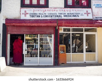 Thiksey, Ladakh, India - circa August 2019: a monk at the local medicine shop in Thiksey Monastery, Ladakh