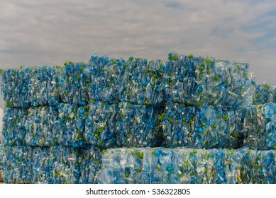 THILAFUSHI, MALDIVES - 30 11, 2016: Stacks of compacted plastic PET bottles ready for recycling site at Thilafushi