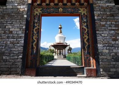 THIMPHU, BHUTAN - August 19, 2016: The National Memorial Chorten, or the Memorial Stupa, a religious landmark being seen through the entrance gate during summer under a clear blue sky.