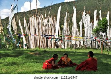 Thimphu, Bhutan - July 7, 2015. Young monk is playing at a monastery in Thimphu, Bhutan.