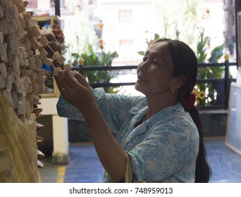 THIMPHU (BHUTAN) - OCTOBER 2017: Local market in downtown Thimphu. A potential buyer examining local cheese.