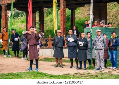 Thimphu, Bhutan - Octorber 2016: Bhutanese men compete in an archery competition in Thimphu, Bhutan.