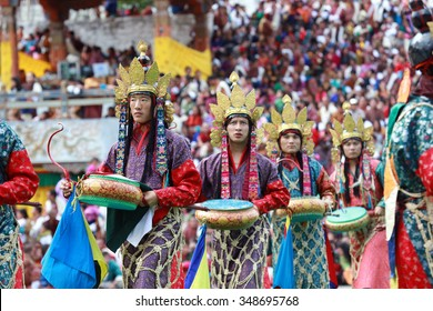 THIMPHU, BHUTAN - SEPTEMBER 25, 2015: A presentation of 16-Dakini dance with golden hat and traditional drums during Thimphu Tshechu.