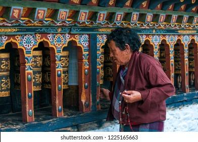 Thimphu/Bhutan - October 2018: A local woman is praying in an old monastery in Thimphu city, Bhutan.