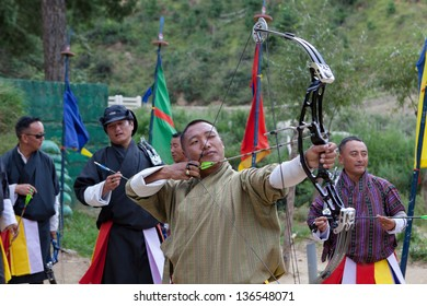 THIMPHU,BHUTAN -SEPTEMBER 22:Bhutanese men compete in a game of archery on September 22,2012 in Timphu,Bhutan. Archery is the most popular game in Bhutan.