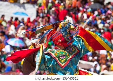 THIMPHU,BHUTAN - SEPTEMBER 26:Costumed monk performs traditional dance at  main buddhist festival in Dzong of Thimphu on September 26,2012 in Thimphu,Bhutan.