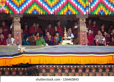 THIMPHU,BHUTAN - SEPTEMBER 26:Spectators watch the festival in Dzong of Thimphu on September 26,2012 in Thimphu,Bhutan. Each year the buddhist festival is the main event in the Thimphu Dzong.