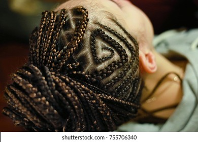 thin braids on the head with drawings, African or ethnic style h