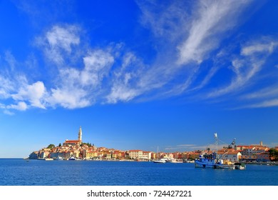 Thin clouds above the distant town of Rovinj and the Adriatic sea, Croatia