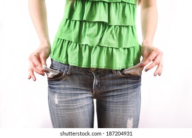 thin female broke college student pulling out pockets to reveal no money isolated on white